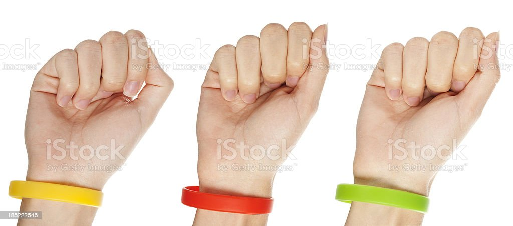 Yellow,green and red  wristbands stock photo