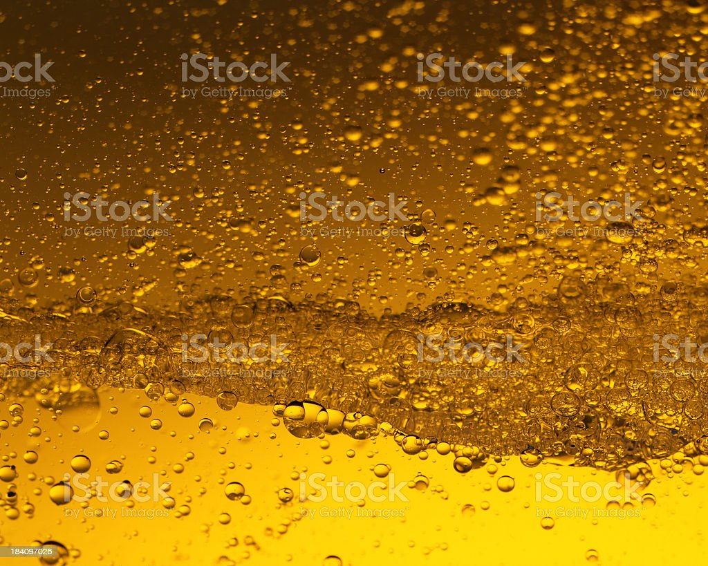 Yellow-hued photo of bubbles in liquid royalty-free stock photo