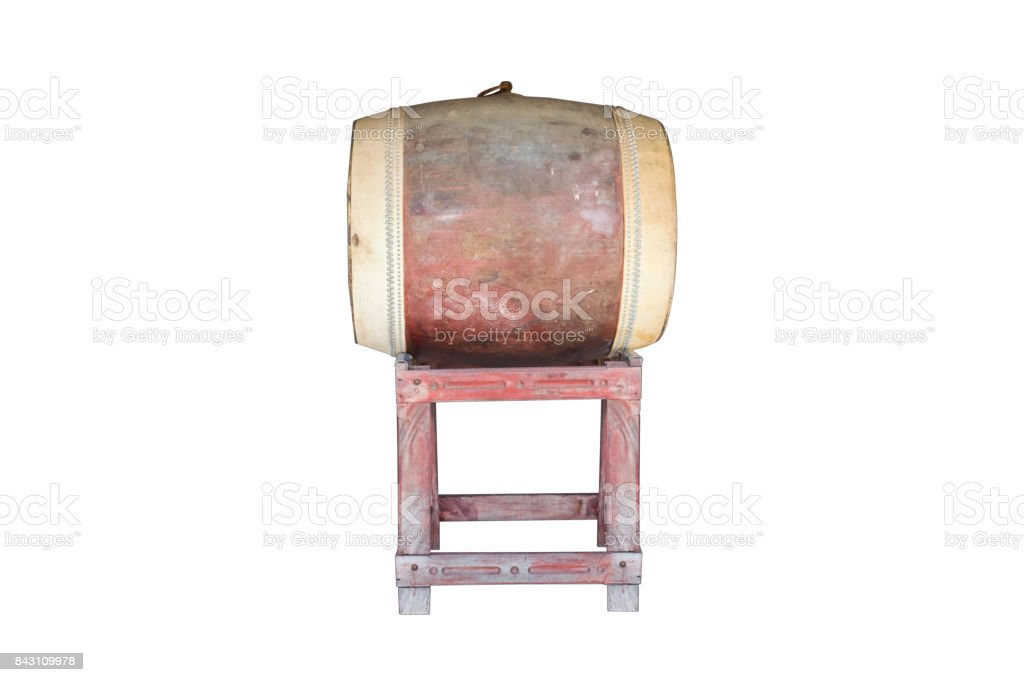 Yellowish old large drum with drum skin fully visible isolated on white with clipping path. The drum is used in temple to notify the time for midday meal. The drum skin side is typically as large as half of human height stock photo