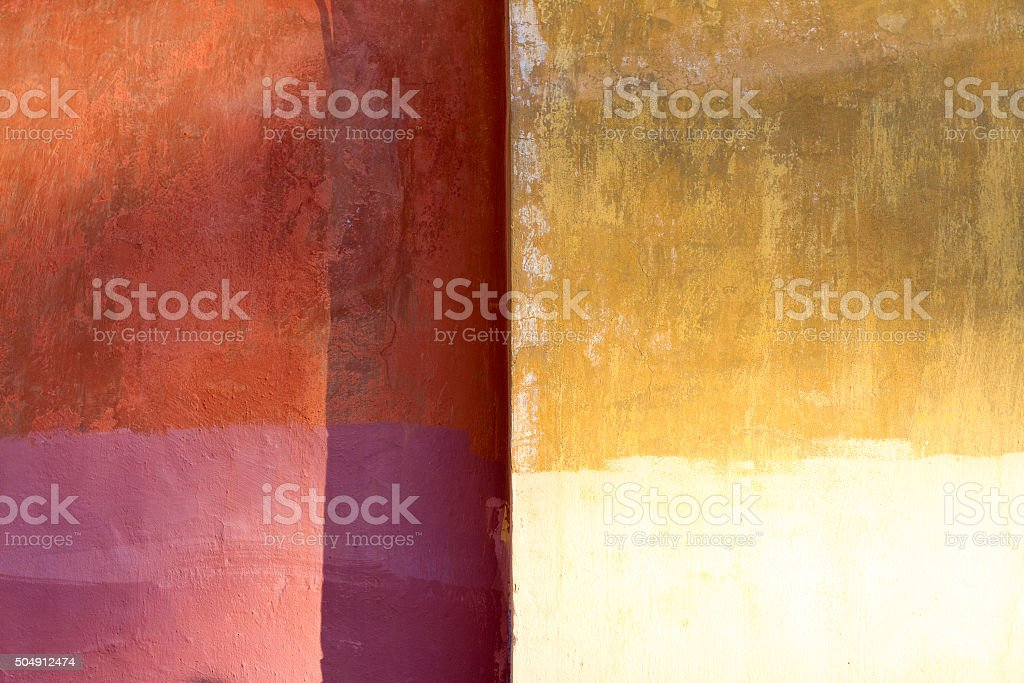 Yellow-Orange-Pink Mottled Roman Wall Background Texture stock photo