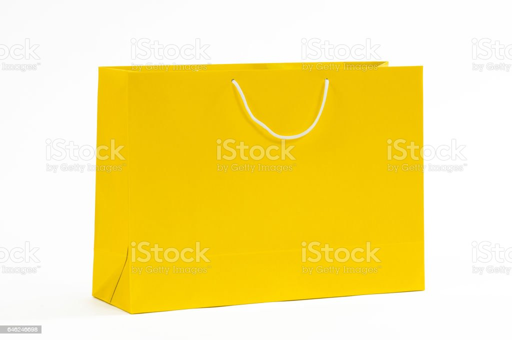 Yellowpaper bag on a white background stock photo