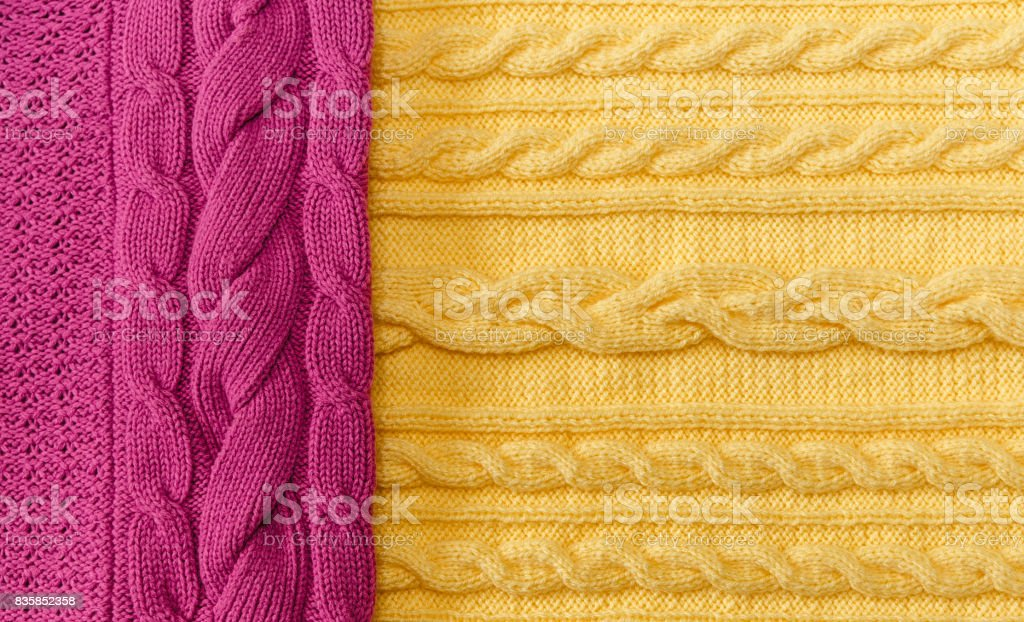 Yellow;Pink Knitted Items with Braids and Pattern.Hand Made;Fancywork.Background. stock photo