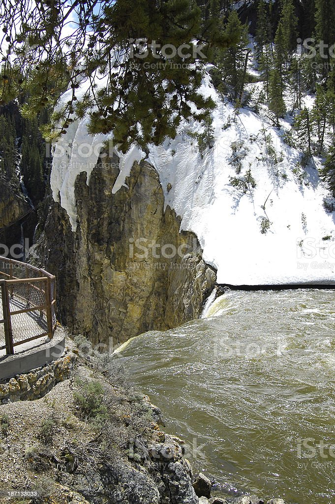Yellowstone National Park Brink of Lower Falls Snowy Waterfall stock photo