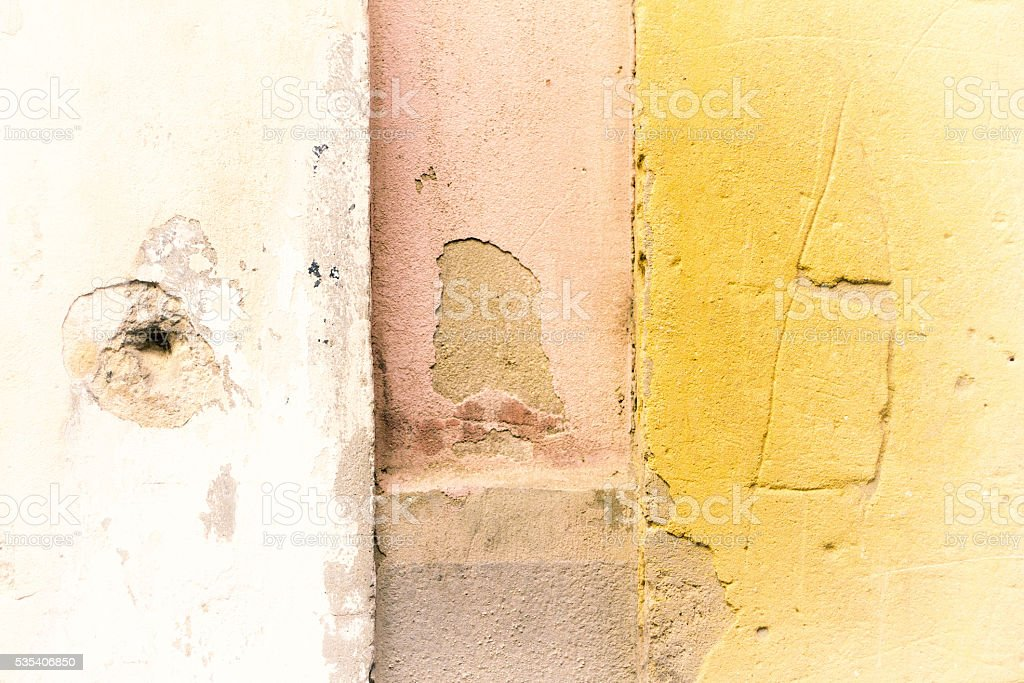 Yellow-White-Pink Mottled Sicilian Wall Background Texture stock photo