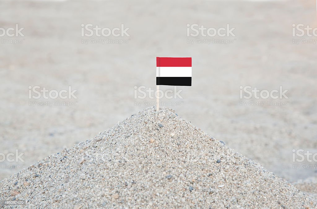 Yemen Flag on the Beach stock photo