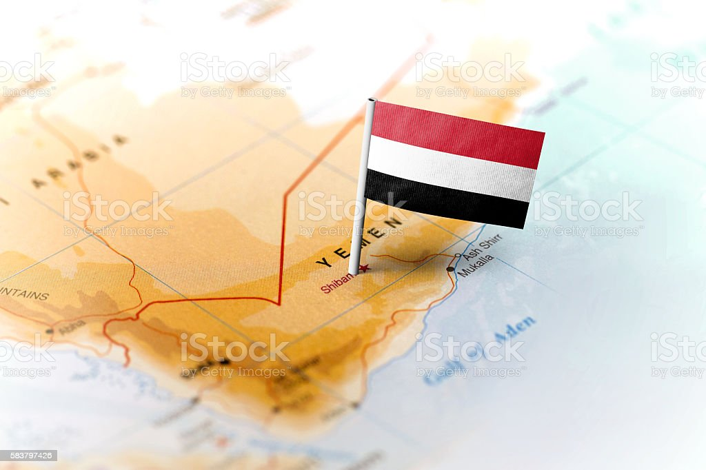 Yemen pinned on the map with flag stock photo