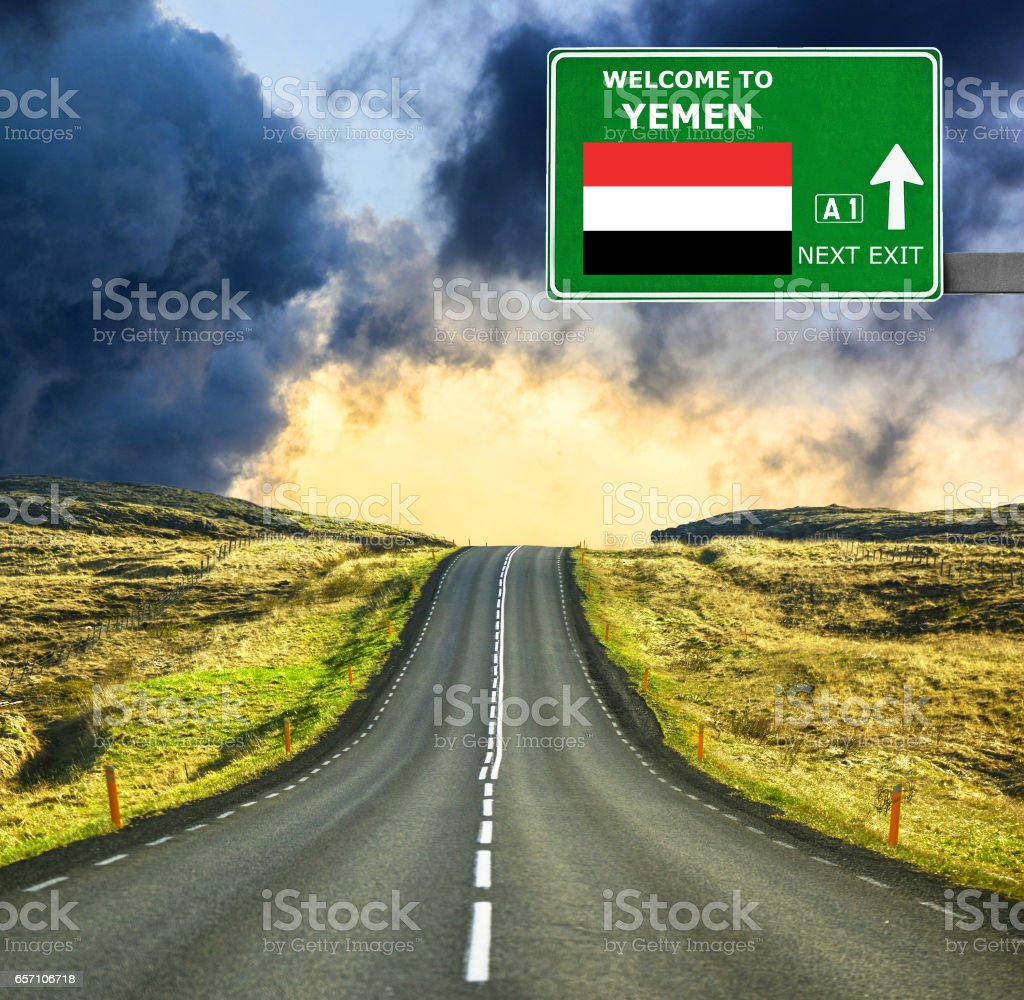 Yemen road sign against clear blue sky stock photo