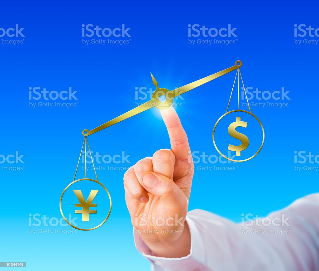 Yen Sign Outweighing The Dollar On A Golden Scale stock photo