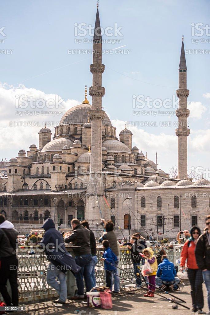 Yeni Cami Mosque and Galata Bridge Fishermen, Istanbul stock photo