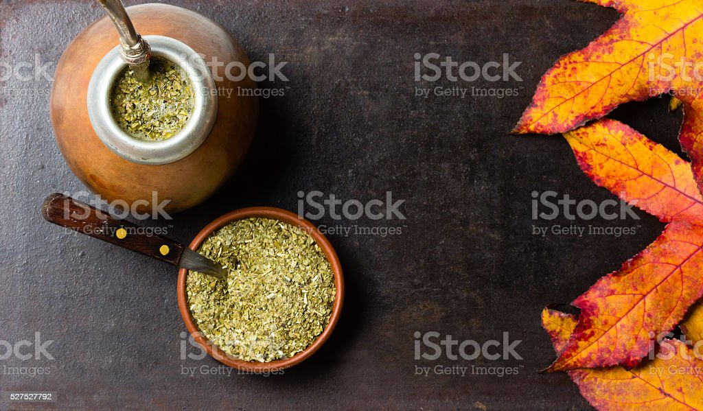 Yerba herb mate latin american tea black background. Top view stock photo