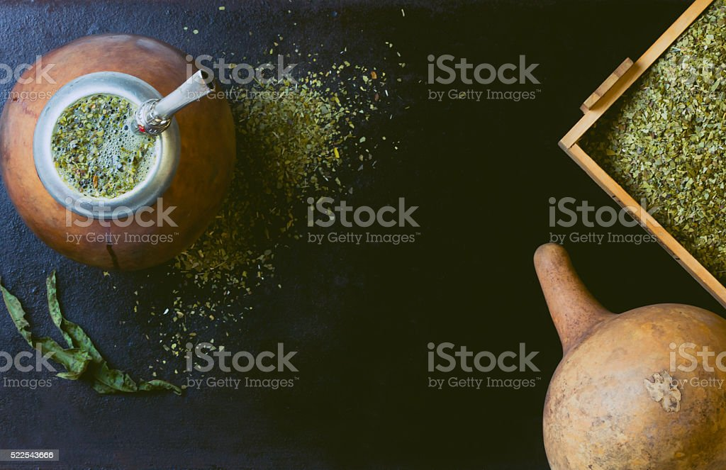 Yerba mate in calabash and wooden box of dry herb. stock photo