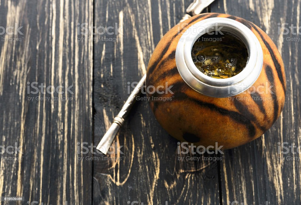 Yerba mate tea in a wooden mate calabash stock photo