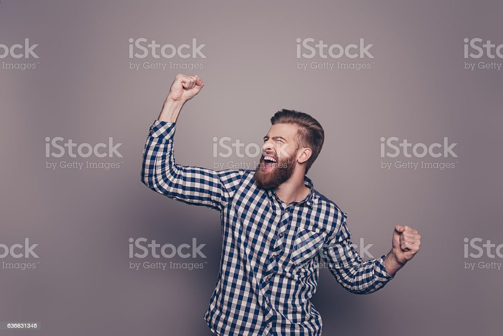 Yes, he did it!  happy bearded man raised hands stock photo