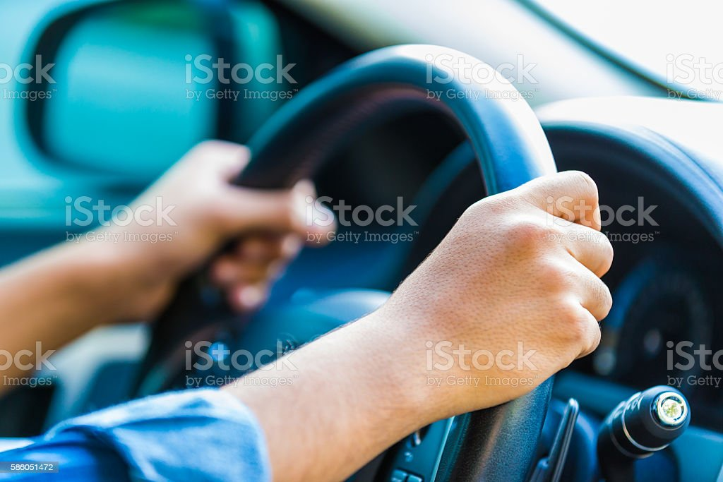 Yes, key to safe driving, both hands on the wheel. stock photo