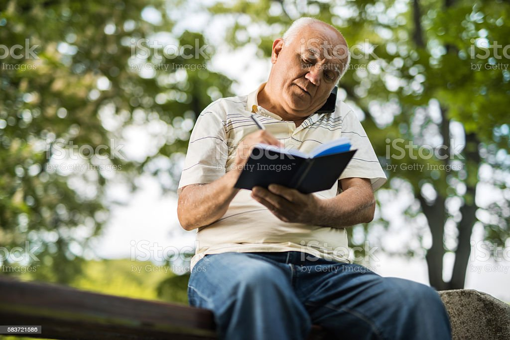 Yes, let me write that down! stock photo