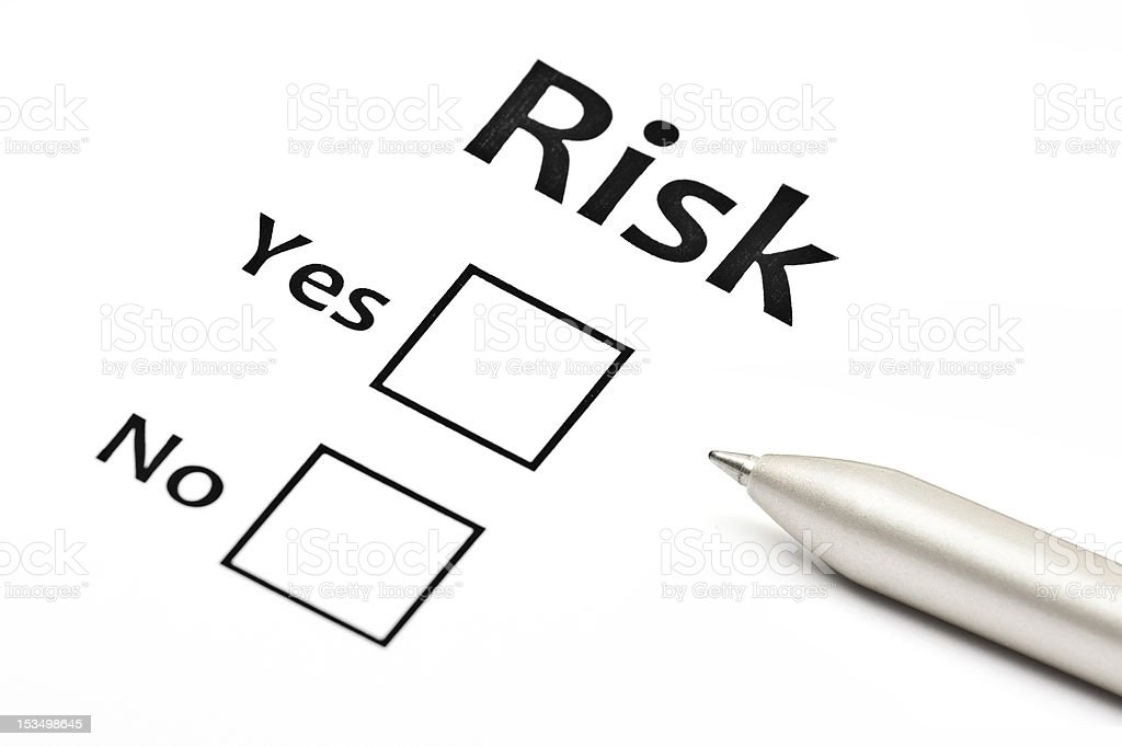Yes or no checklist for risk on paper with a silver pen royalty-free stock photo