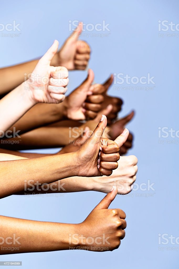 Yes! We approve! Many hands giving thumbs-up sign stock photo