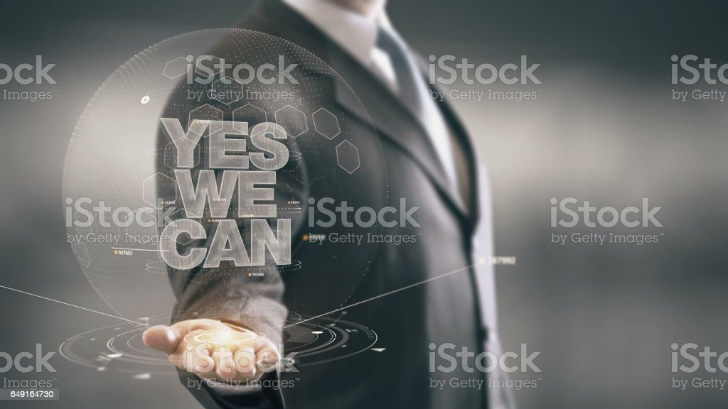 Yes We Can Businessman Holding in Hand New technologies stock photo