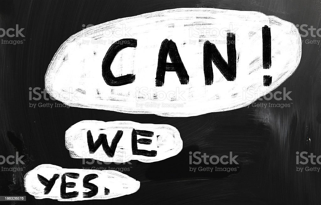 'Yes, we can!' handwritten with white chalk on a blackboard stock photo