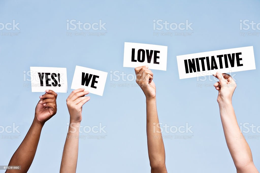 'Yes! We love initiative' say hand-held signs stock photo
