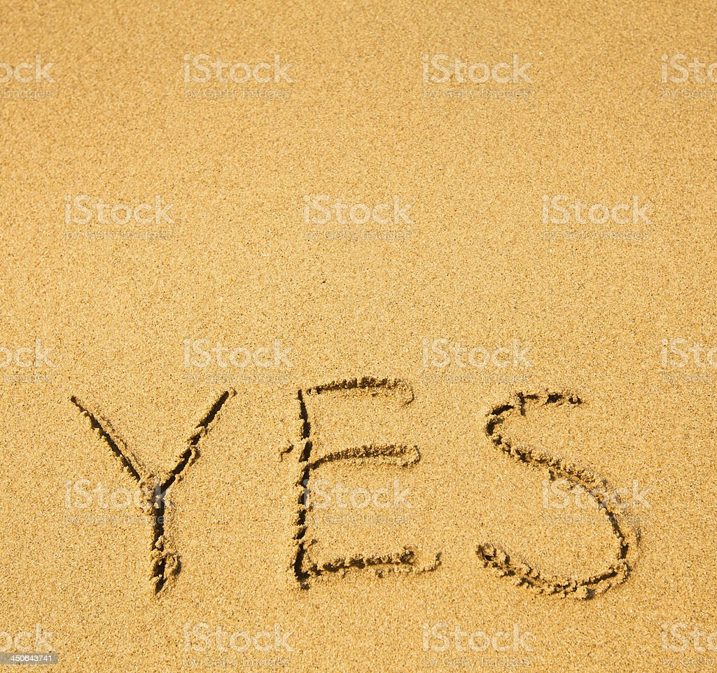 Yes - written in sand texture. stock photo