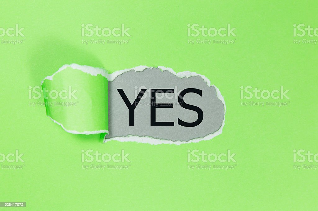 yes written under black torn paper. stock photo