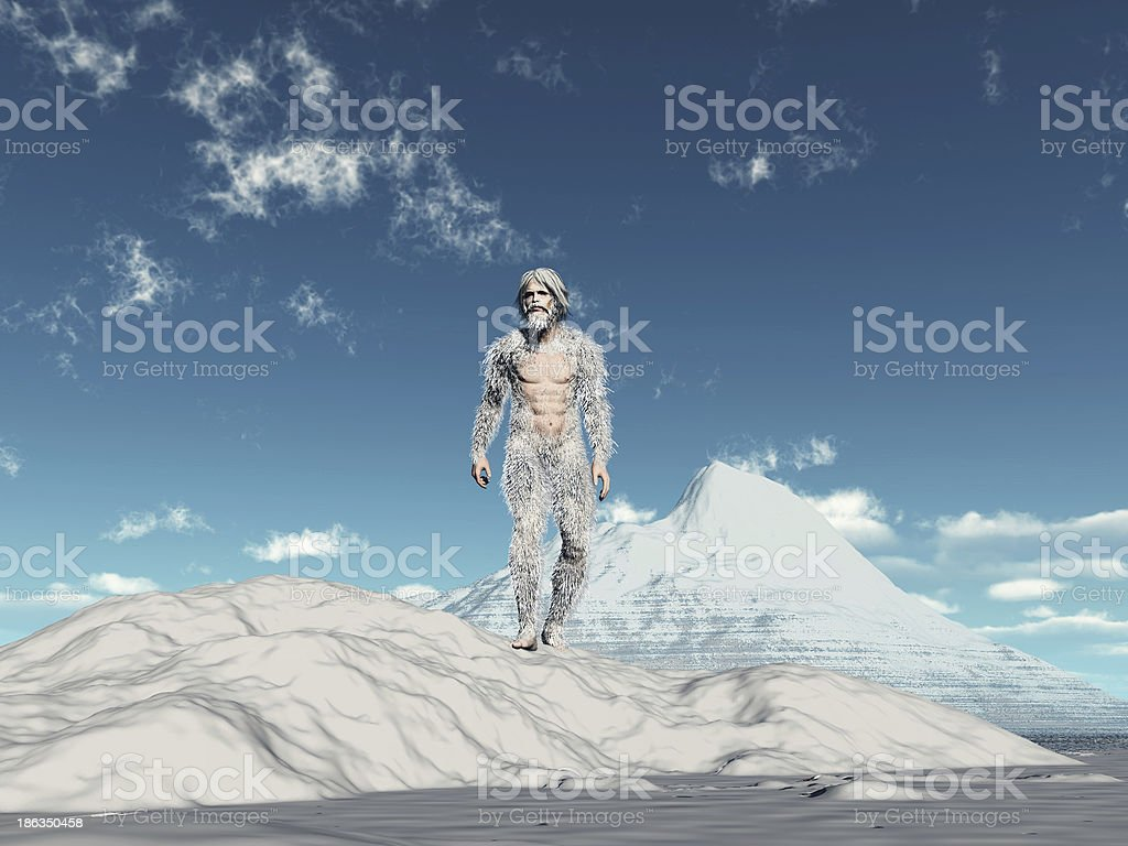 Yeti walking on snow with snow capped mountain in background stock photo
