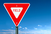 Yield Road Sign Post Over a Blue Sky