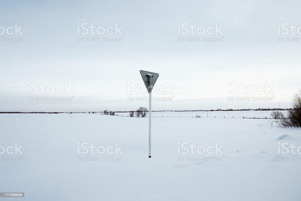 Yield - road sing in field, winter season stock photo