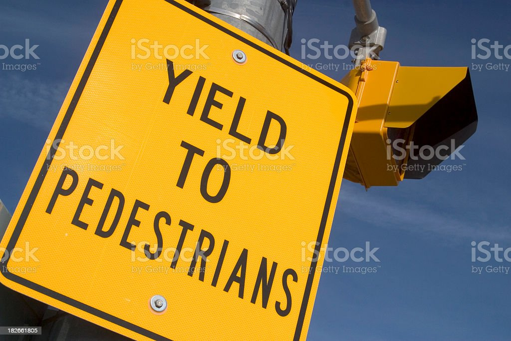 Yield To Pedestrians Sign and Light stock photo