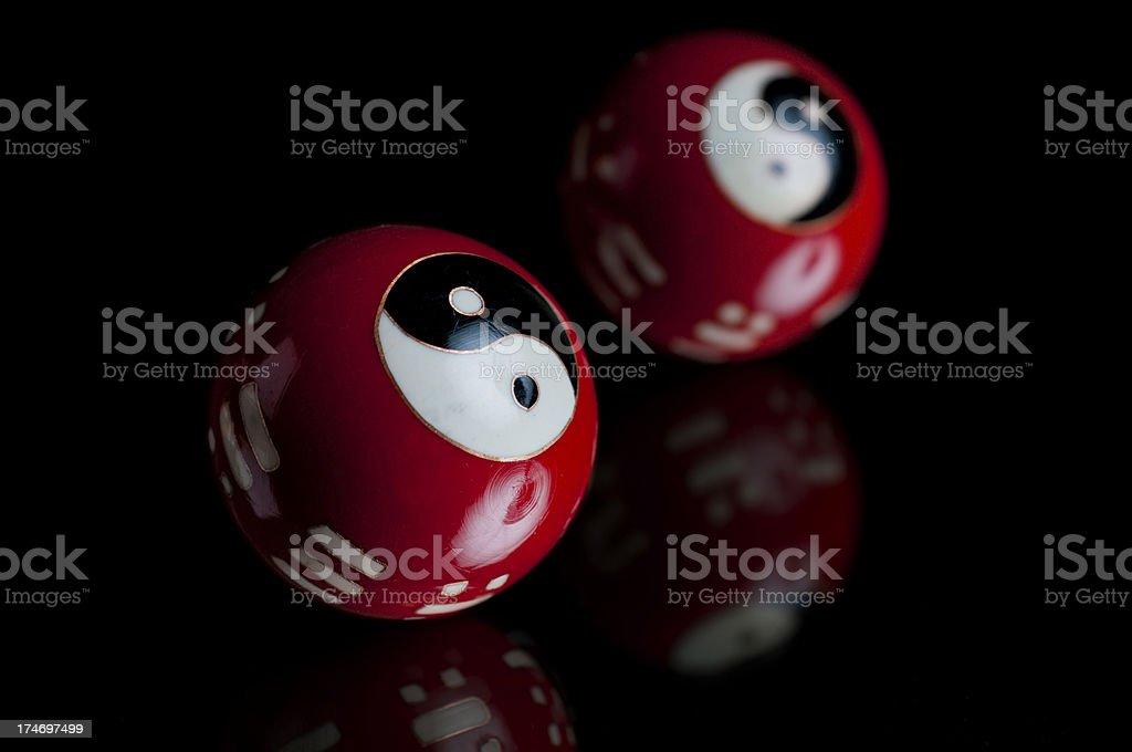 Yin and Yang Baoding Balls on Black Background stock photo