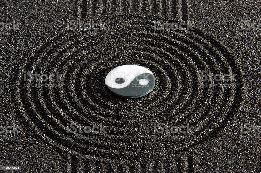 Yin and yang symbol in center of Japanese Zen garden stock photo