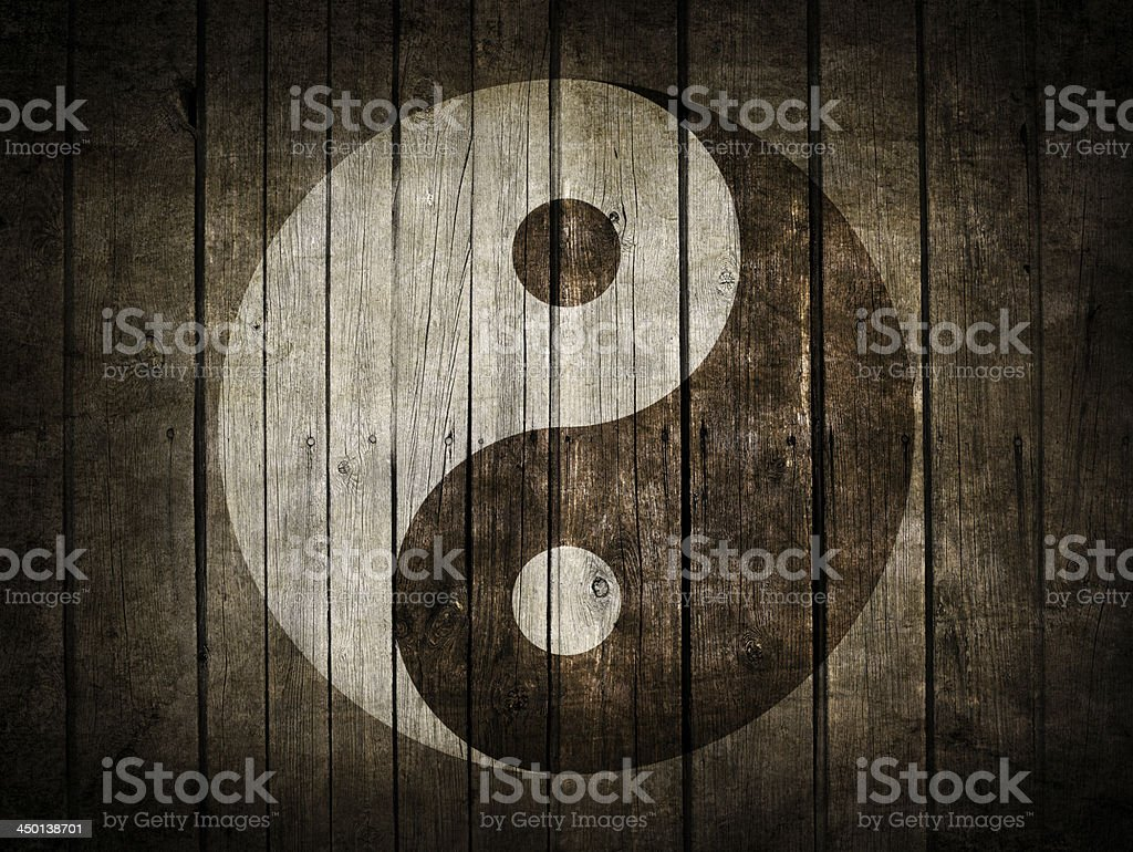Yin and yang symbol on dark wood background stock photo