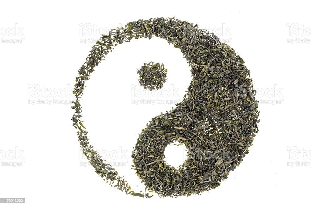 Yin yang shaped display of tea leaf stock photo