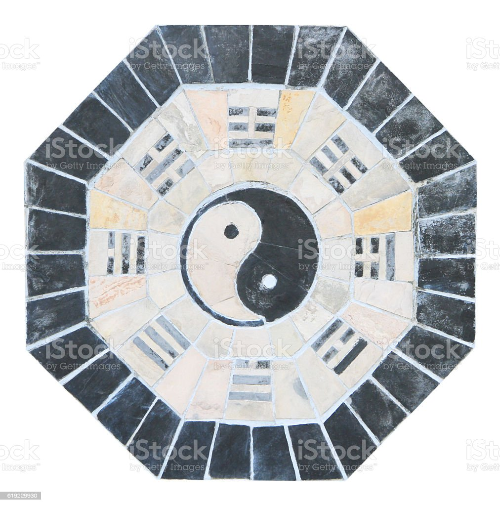 Yin yang sign on old tiled wall stock photo