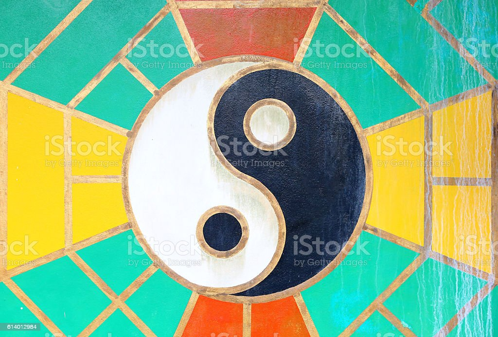yin yang sign on the grunge wall of Chinese temple. stock photo