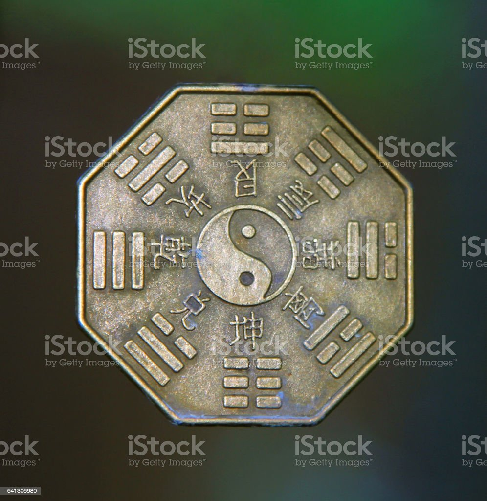 yin yang sign surrounded by Trigrams and hieroglyphs stock photo