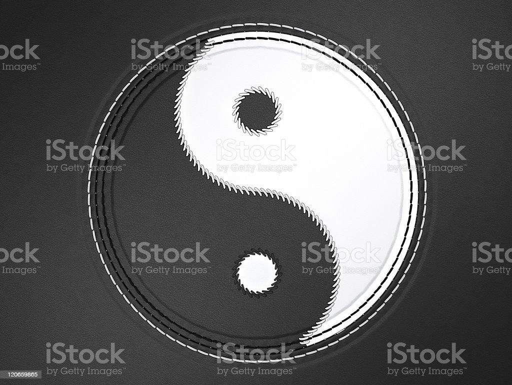 Ying yang stitched symbol on leather royalty-free stock photo