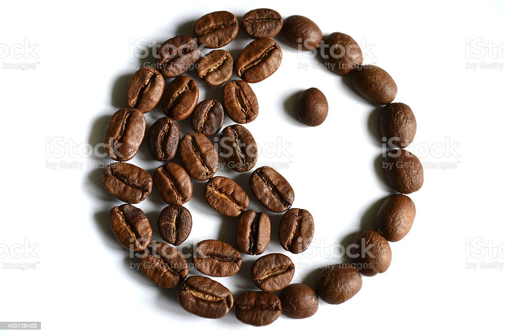 Yin-yang symbol made of coffee beans royalty-free stock photo