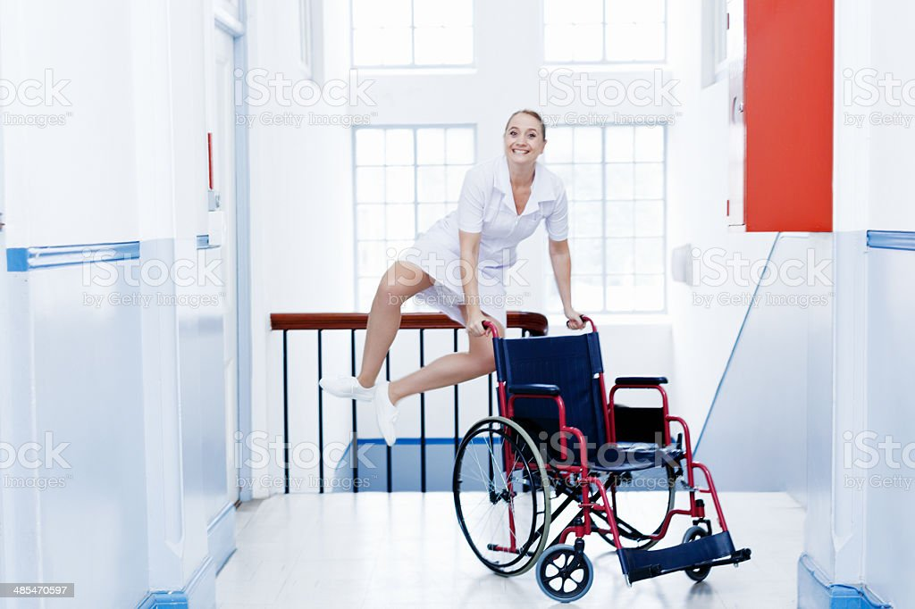 Yippee! Nurse leaps in air, smilling. End of shift perhaps? stock photo