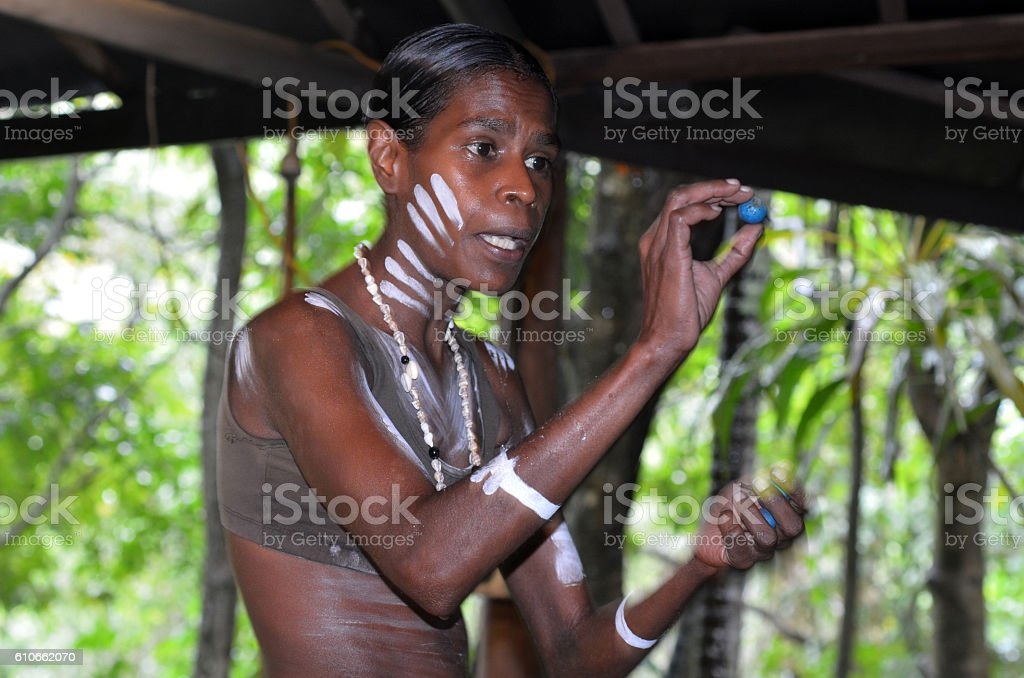 Yirrganydji Aboriginal woman explain about the fruit and seeds f stock photo