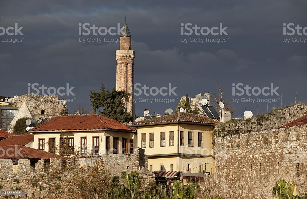Yivli Minaret and old houses in Kaleici of Antalya royalty-free stock photo