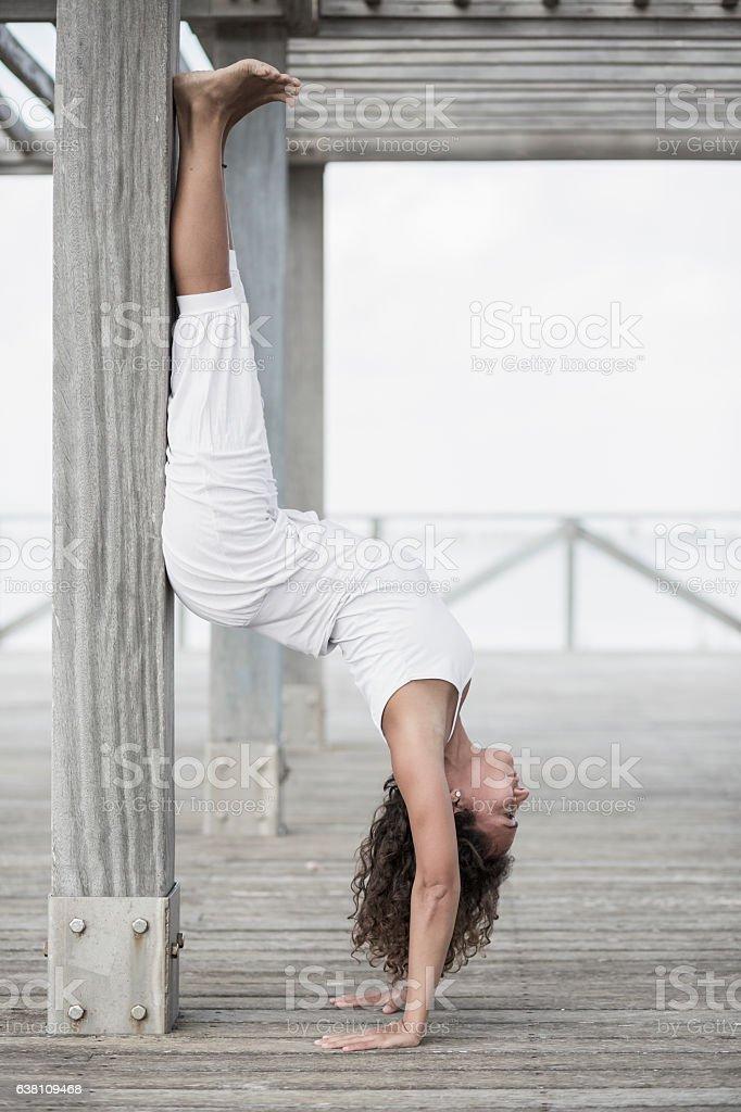 Yoga adho mukha vrksasana stock photo