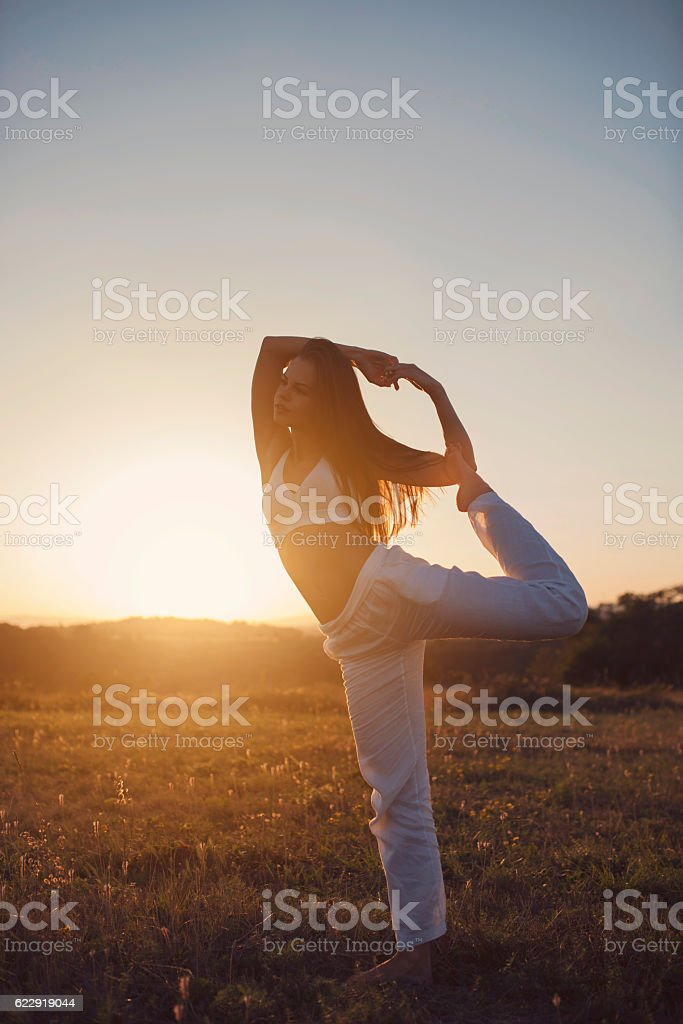 Yoga and the sunset stock photo
