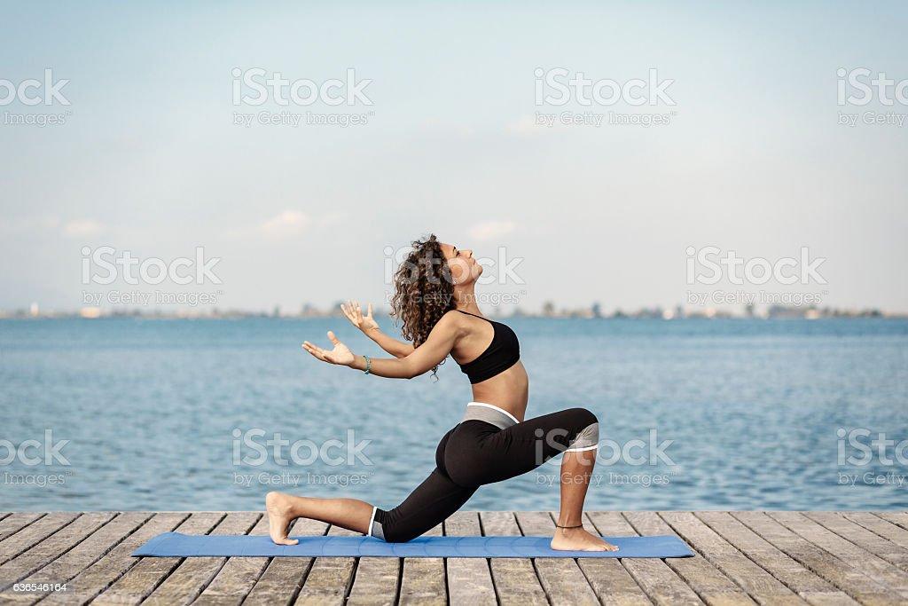 Yoga Anjaneyasana stock photo
