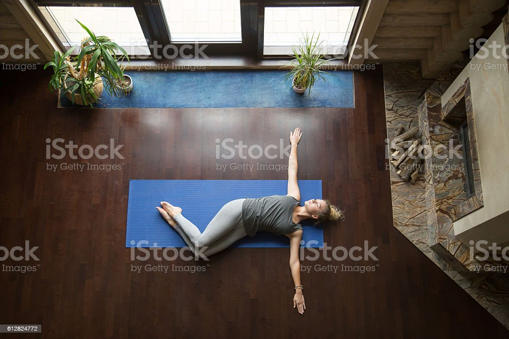 Yoga at home: Belly Twist Pose stock photo