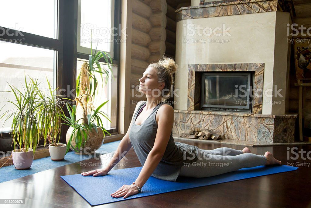 Yoga at home: Cobra Pose stock photo
