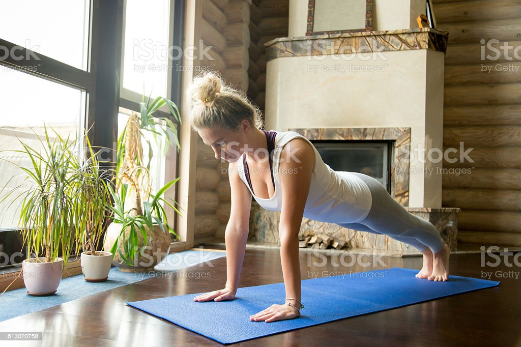 Yoga at home: plank pose stock photo
