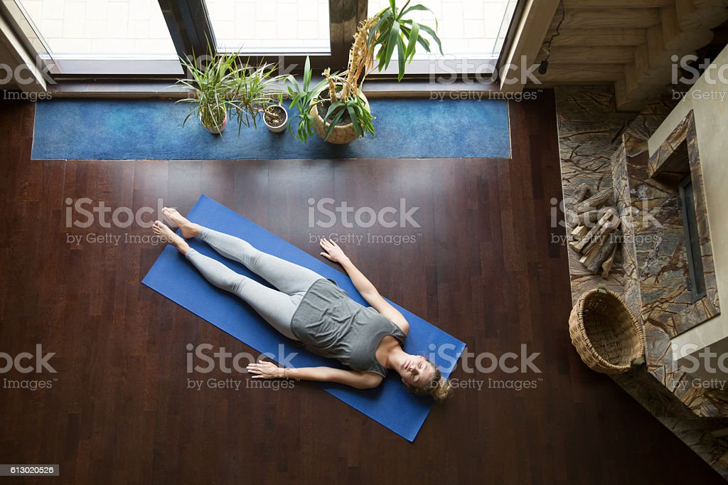 Yoga at home: relaxation stock photo