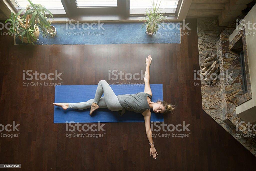 Yoga at home: Revolved Abdomen Pose stock photo